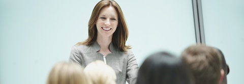 Woman presenting in front of class