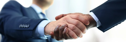 2 men shaking hands  - making a deal