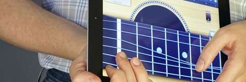 playing guitar on a mobile device