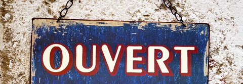 a sign with the word 'Ouvert' meaning 'Open' in french