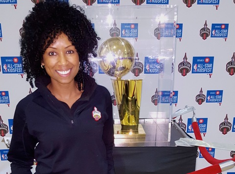 Jodine Mitchell with NBA All-Star Trophy
